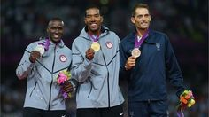 Gold medalist Christian Taylor (C) of the United States celebrates on the podium with silver medalist Will Claye (L) of the United States and bronze medalist Fabrizio Donato of Italy during the medal ceremony for the Men's Triple Jump on Day 13 of the London 2012 Olympic Games at Olympic Stadium.