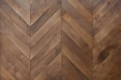 Reclaimed brown walnut parquet flooring from www.element7.co.uk laid in a chevron pattern