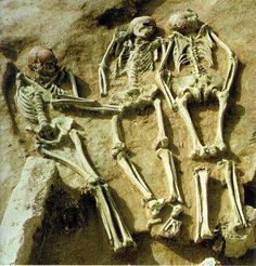 """+/-26000 year old drama or mystery... The skeletons lean into each other, like nestled question marks. In his written report, Klima speculated that the arrangement of the grave might reflect """"a real life drama which precipitated the burials."""" His drama revolved around a young woman who had died in childbirth. The two male skeletons where those of her husband and a medicine man-the man wearing the mask. Held responsible for her death, the men had been compelled to follow her into the…"""