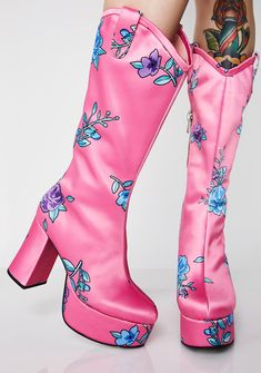 Sugar Thrillz Wilder Out West Boots cuz you can't be tamed. These pink boots have platform soles, chunky heels, a cute af floral print, and inside zipper closures.