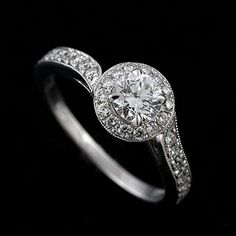 Image from http://www.orospot.com/images/products/round-diamond-asymmetrical-micro-pave-engagement-ring-14k-white-gold-r1020ven_1.jpg.