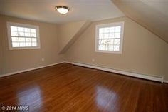 Large bedroom with vaulted ceiling and hardwood flooring. COMPLETELY remodeled 3 bed/2.5 Bath Single Family Home in Woodbridge, VA  $289,990  Looking to Sell, Buyer or invest?  Info@AJTeamRealty.com or SellMyHome.NOVA