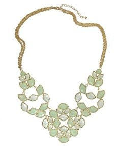 Grayce Statement Necklace in Aster from Kendra Scott - I like the large cut outs in the sillhouette itself- it leaves a new color- the wearer's skin tone- be a part of the color pallate for the necklace.
