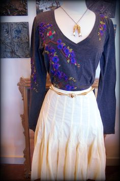 JW of LA detail embroidered shirt with vintage bungee cord belt on For Joesph pleated skirt