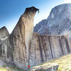 [instagram][photo]@seanleary completes his first route up the belly of Penguin Rock in Nahannai's Cirque of the Unclimbables, Canada.