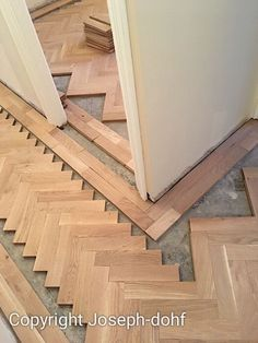 floor transition idea : Herringbone parquet in living room, border of wood in hallway with Encaustic clay tile runner in the center, this could work beautifully. Herringbone Tile Floors, Wood Tile Floors, Timber Flooring, Parquet Flooring, Hardwood Floors, Herringbone Pattern, Wood Floor Pattern, Wood Floor Design, Hall Flooring