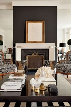 Stellar fireplace!! Black accent wall, gold frame