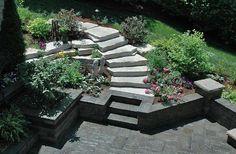 limestone steps, limestone outcrop, outdoor steps, seat wall, patio, walk out basement, Unilock