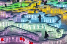 Visitors walk in an ice maze in Harbin international ice and snow festival