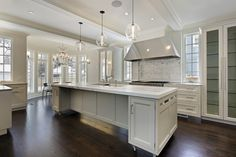White kitchen cabinets and dark wood floor....what more can you ask for?  Love the bow window in the dining area!