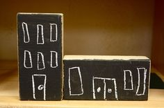 Scrap lumber painted with chalkboard paint. Awesome! Kids can build huge cities!