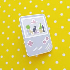 This lovely pastel coloured Gameboy pin badge is perfect for gamers who want to accessorise! It features tiny Tetris blocks in a rainbow of pastel shades. Pin b