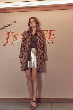Leopard-print coat, £25; metallic blouse, £12; silver mini skirt, £12; velvet platform heels, £12, all Primark