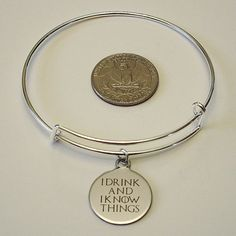 Show your love for Tyrion Lannister and Game of Thrones with this beautiful expandable bangle bracelet. Style: Expandable Bangle Size: 2.5 inches / 65 mm diameter Color: Antique Silver  Product Includes: One bangle bracelet with attached charm