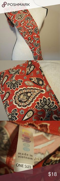 OS Lularoe red paisley leggings Red (not a true red) background with cream, dark brown, and a blue/green paisley pattern. I cannot guarantee leggings as I am not a consultant and Lularoe has known issues but these leggings were never worn. I do not have tags because Lularoe does not attach a tag to their leggings, only puts it in the bag the consultant receives. I am destashing my collection. LuLaRoe Pants Leggings