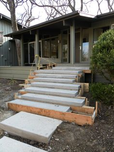 Concrete Steps Floating concrete steps sitting in forms are sitting upon a footer that supports the steps from the middle. Floating concrete steps sitting in forms are sitting upon a footer that supports the steps from the middle. Concrete Porch, Concrete Stairs, Diy Concrete, Wood Stairs, Concrete Front Steps, Cement Steps, Precast Concrete, Painted Stairs, Concrete Garden