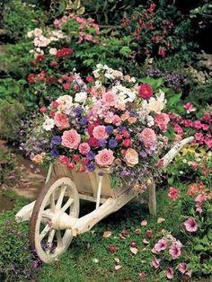 wheelbarrow planting pot with flowers