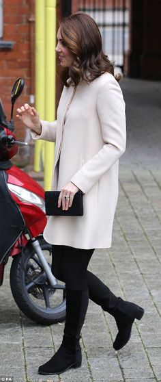 Kate opted for a monochrome look for the visit, which was rescheduled after she had to pull out of her planned engagement in September