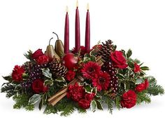 Pine cones, red roses, red shasta daisy's, purple grapes pomegranate, Pears, holly, cedar boughs, cinnamon sticks and candles.     christmas flowers ideas 15