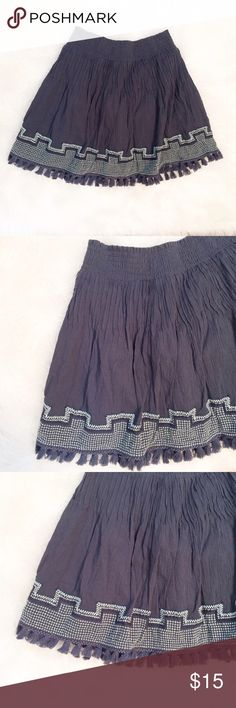 J. Crew fringe bottom skirt In excellent used condition! Fringe bottom skirt by J. Crew with elastic waist. This is an XXS but the elastic waist band allows it to fit an XS to even a Small. Measurements to come. This skirt is gray with a blue undertone, it's very comfortable and flattering! Listing as an XS as this is a more accurate size. J. Crew Skirts