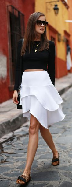 Andy Torres is wearing a white skirt and black top from H&M, a bag from Proenza Schouler and the sunglasses are from Celine