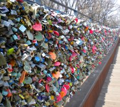 Locks of Love, Seoul, South Korea.   Literally thousands of lovers' locks can be seen attached to the fencing that surrounds Mt. Namsan's N Seoul Tower in Central Seoul. There even exists a special bin in which to place keys following the accumulation of hundreds around the fence.