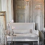 living rooms - antique French doors rustic wood floors  French living space with Aidan Gray Isla Settee, rustic wood floors, Aidan Gray Astre