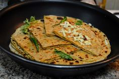 All are familiar with the recipe of Paneer Paratha, but just to overcome the blandness of paneer, I decided to add some finely chopped capsicum. What I like about this paratha is that the stuffing needs no cooking on the stove. It can be made in a bowl, unlike my previous recipe of Aloo Paratha, where we need to cook the potato stuffing, cool it and then make the paratha.If you have Paneer in your refrigerator, then this paratha can be a quick fix in case if you unexpected guest, a quick…