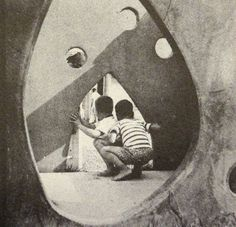 "Two boys are pictured in this Creative Playthings catalog photo from 1956.  They are inside a ""play sculpture"" sold by the company, one of many outside play structures created in the 1950s and 1960s."