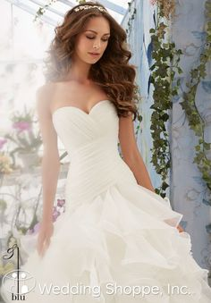 A beautiful organza wedding dress with fitted sweetheart neckline bodice and flirty ruffled skirt.