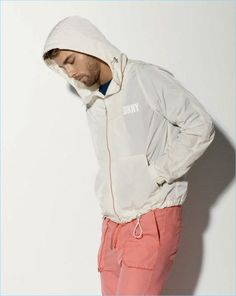 DKNY channels a sporty vibe for its spring-summer 2018 collection. The brand's urbanite receives a stylish update with a splash of color. Shades of yellow… Young Men, Young Fashion, Shades Of Yellow, Spring Summer 2018, Men's Collection, Color Splash, Rain Jacket, Windbreaker, Sporty