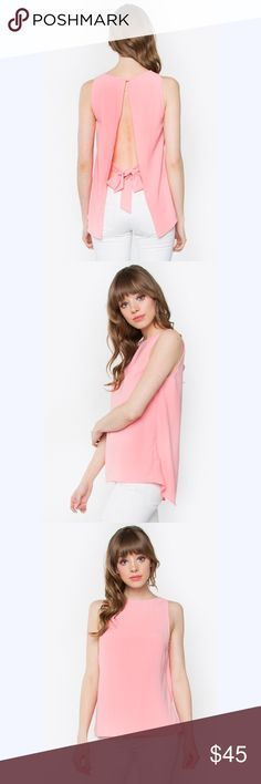 "🆕Open Back Sleeveless Top - Flyaway back with tie detail sleeveless top - Back button with elastic loop closure - Jewel neckline - Color: Peach  Size + Fit - Model is wearing size S - Measurements taken from size S - Length: 23""(Center front) - Chest: 35.5"" -Fabric: 100% Polyester Tops Blouses"