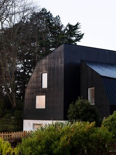 the home\'s configuration allows for an open staircase that connects a series of interconnected volumes, rather than individual rooms.