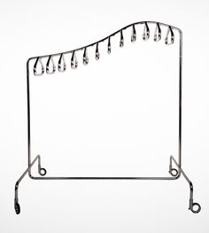 DIPLODOCUS is a line of minimalist yet design savvy clothes racks. They come in four versions mountable and 2 freestanding) and would . Dinosaur Outfit, Clothes Drying Racks, Polished Chrome, Wardrobe Rack, My Outfit, Hanger, Modern, How To Wear, Furniture