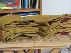 Finished custom order for Much Ado Books. Ochre denim aprons with burgundy and dark green ties.