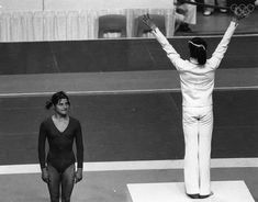 26th July 1976: Romanian athlete Nadia Comaneci celebrating her gold medal for the beam at the Montreal Olympics, while the silver medal winner and Russian athlete Olga Korbut looks on. (Photo by Reg Lancaster/Express/Getty Images) Add Around The Rings on www.Twitter.com/AroundTheRings & www.Facebook.com/AroundTheRings for the latest info on the Olympics.