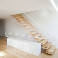 An impressively long unsupported floating handrail. Via home edit by A+R Arquitectos