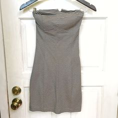 """Strapless Striped Club Monaco Dress Strapless striped Club Monaco dress with v front detailing! This dress has a rubber ring around the top to help hold the dress up as well. 70% viscose 25% Nylon and 5% elastase. Worn twice and in great condition! I am 5'3"""" for length reference. No trades  Club Monaco Dresses Strapless"""