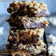 Fudge Brownie, Caramel, Popcorn and Oatmeal Cookie Crumble 7 Layer Bars.oh my gosh. Easy Dutch Oven Recipes, Dutch Oven Desserts, Baking Desserts, 7 Layer Bars, Oatmeal Cookie Bars, Healthy Dark Chocolate, Dutch Oven Camping, Fudge Brownies, Brownie Bar