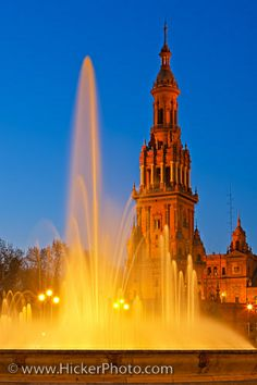 Tower and fountain at the Plaza de Espana, Parque Maria Luisa, during dusk in the City of Sevilla (Seville), Province of Sevilla, Andalusia (Andalucia), Spain, Europe.   Excursions in Barcelona Excursions in Barcelona Vacations in Barcelona Sightseeing tours, airport transfers, taxi, interpreter and your personal guide in Bar