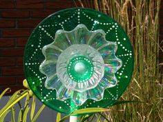 Hand Painted Glass Garden Flower Sculpture, Sun Catcher, Recycled. $40.00, via Etsy.