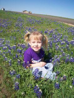 Kara in a field of bluebonnets