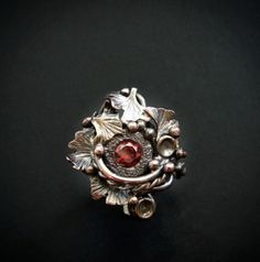 A red cubic zirconia takes center stage in this handcrafted ring. Ginkgo leaves, swirls and dots in copper embrace the dark red zirconia. Copper Rings, Copper Necklace, Copper Color, Agate Stone, Yellow And Brown, Handmade Design, Fashion Art, Bronze, Unique Jewelry