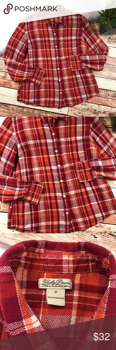 Lucky brand fall colored flannel Size medium. In excellent condition, no flaws! This flannel is the perfect flannel for fall! Has more of an orange red color scheme that makes it stand out. Super soft and cozy! Length-24, bust-20 pit to pit ***NO modeling or trades!! ::262 Lucky Brand Tops Button Down Shirts