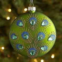 Peacock Feather Disc Ornament $4.95 www.allthingspeacock.com