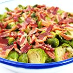 Wash, trim and cut Brussels sprouts in half. Heat a medium skillet over medium-high heat. Brown