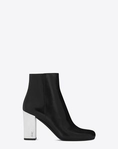 SAINT LAURENT BABIES 90 ANKLE BOOT IN BLACK LEATHER, MIRRORED FAUX LEATHER AND SILVER-TONED METAL. #saintlaurent #shoes #