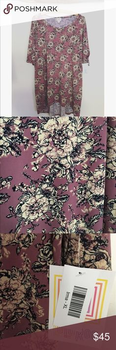 🦄 Lularoe Irma Beautiful Irma. The most amazing color of purple with black and cream Floral print. Fits 2x-3X LuLaRoe Tops