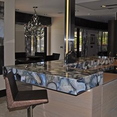 SEMI-PRECIOUS | GRAY AGATE Breathtaking countertop featuring Gray Agate semi-precious stone. Fabrication and installation provided by Eurostar Marble and granite, Inc. #MarbleOfTheWorld