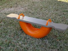 Tire see saw...... made from an old tire, pine wood board, play gym handles and some spray foam to fill in tire.(did not want any snakes getting comfy inside the tire). Painted everything then sprayed some clear enamel spray paint to protect it. Although I don't think I like the foam- it doesn't seem to rock as good as it did without it. Found the idea here: http://www.pinterest.com/pin/8796161746407549/